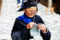 A elderly Miao woman sewing, Upper Langde Miao Village, Leishan County, Qiandongnan Miao and Dong Autonomous Prefecture, Guizhou Province, China