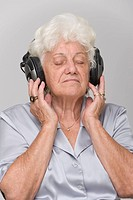 older woman listening to music