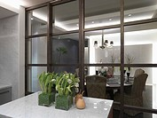 Sliding glass doors separating kitchen from dining room
