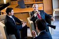 High angle view of Hispanic businessmen talking in office