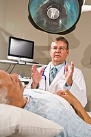 Doctor explaining to patient in hospital room