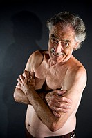Portrait of happy bare_chested senior man, studio shot