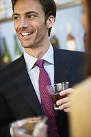 Businessman having drink in a bar