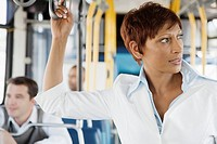 Businesswoman riding public bus