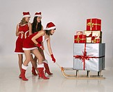 Three girls in christmas disguise
