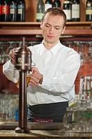 Barman pouring beer at pub