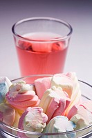 Marshmallow candies and pomegranate juice