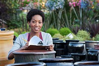 African woman working in garden nursery