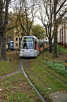 Modern tram, type NF8U, turning at Spichernplatz, Duesseldorf, North Rhine-Westphalia, Germany, Europe