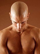 Bald man looking pensive