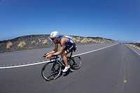 The Belgian professional triathlete Bert Jammaer on the bike course of Ironman Triathlon World Championship in Kailua-Kona, Hawaii, USA