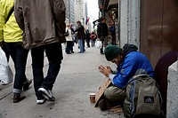 Homeless man prays for help, New York City, New York, USA