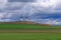Farm fields and windmills, approaching storm, Trembleque, Castilla_La Mancha, Spain, Europe