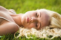 Young woman sleeping in the grass