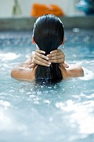 Rear view of a woman in a swimming pool (thumbnail)