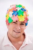 Portrait of a man wearing a flower cap
