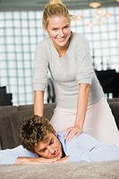 Woman massaging a man's shoulders