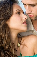 Close-up of a couple romancing (thumbnail)