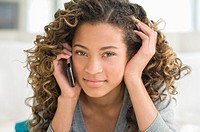 Portrait of a girl talking on a mobile phone (thumbnail)