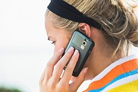Close_up of a woman talking on a mobile phone