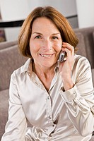 Portrait of a woman talking on a mobile phone