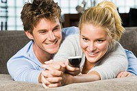 Couple holding a remote control and smiling