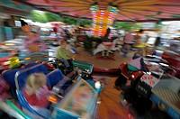 Children's carousel in motion, Munich, Upper Bavaria, Bavaria, Germany, Europe
