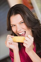 Woman eating corn on the cob