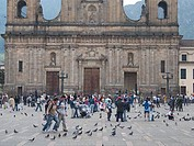 Tourist in front of a church, Bolivar Square, Bogota, Colombia