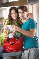 Couple holding a shopping bill