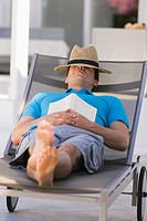 Man sleeping on a lounge chair