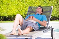 Man resting on a lounge chair