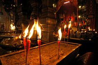 Burning candles in front of a Chinese Buddhist altar in the Man Mo Temple, Hong Kong, China, Asia