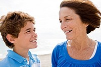 Woman and her grandson looking at each other and smiling