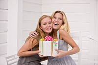 Woman giving a present to her friend