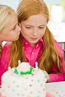 Close_up of a girl celebrating her birthday with her friend