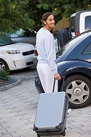 Man standing with luggage (thumbnail)