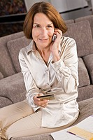 Woman talking on a mobile phone and holding a credit card