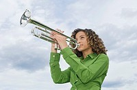 Low angle view of a girl playing a trumpet (thumbnail)