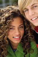 Portrait of a teenage boy smiling with a girl