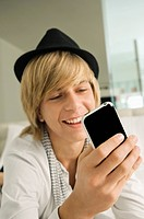 Teenage boy using a mobile phone (thumbnail)