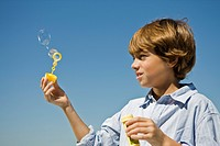 Boy holding a bubble wand