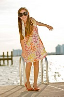 Girl standing on a jetty and smiling