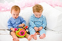 Two babies playing with toys