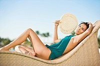 Woman reclining on a chaise longue and holding a hand fan (thumbnail)