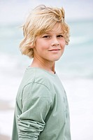 Portrait of a boy standing on the beach