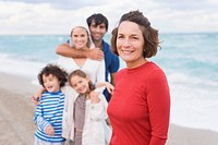 Woman smiling with her family on the beach