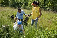 Detroit, Michigan - Volunteers pick up trash in Eliza Howell Park  They were part of the annual Rouge Rescue, in which volunteers clean trash and debr...