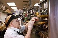Detroit, Michigan - Angela DiNoto takes a patty from a food warmer to make a sandwich at a McDonald´s Restaurant  The company was celebrating its 50th...