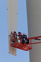 Workers attach sensors to one of the blades of a wind turbine, wind power research at the National Renewable Energy Laboratory's Wind Technology Cente...